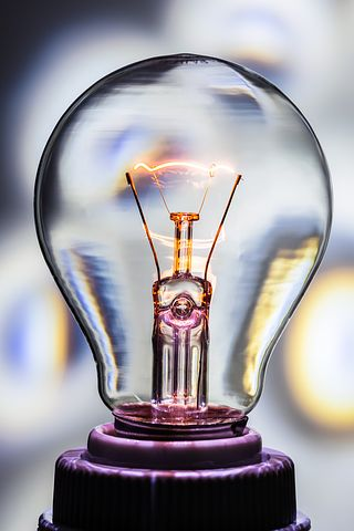An industrial looking light bulb, connected to a user's smartphone as part of the Internet of Things.